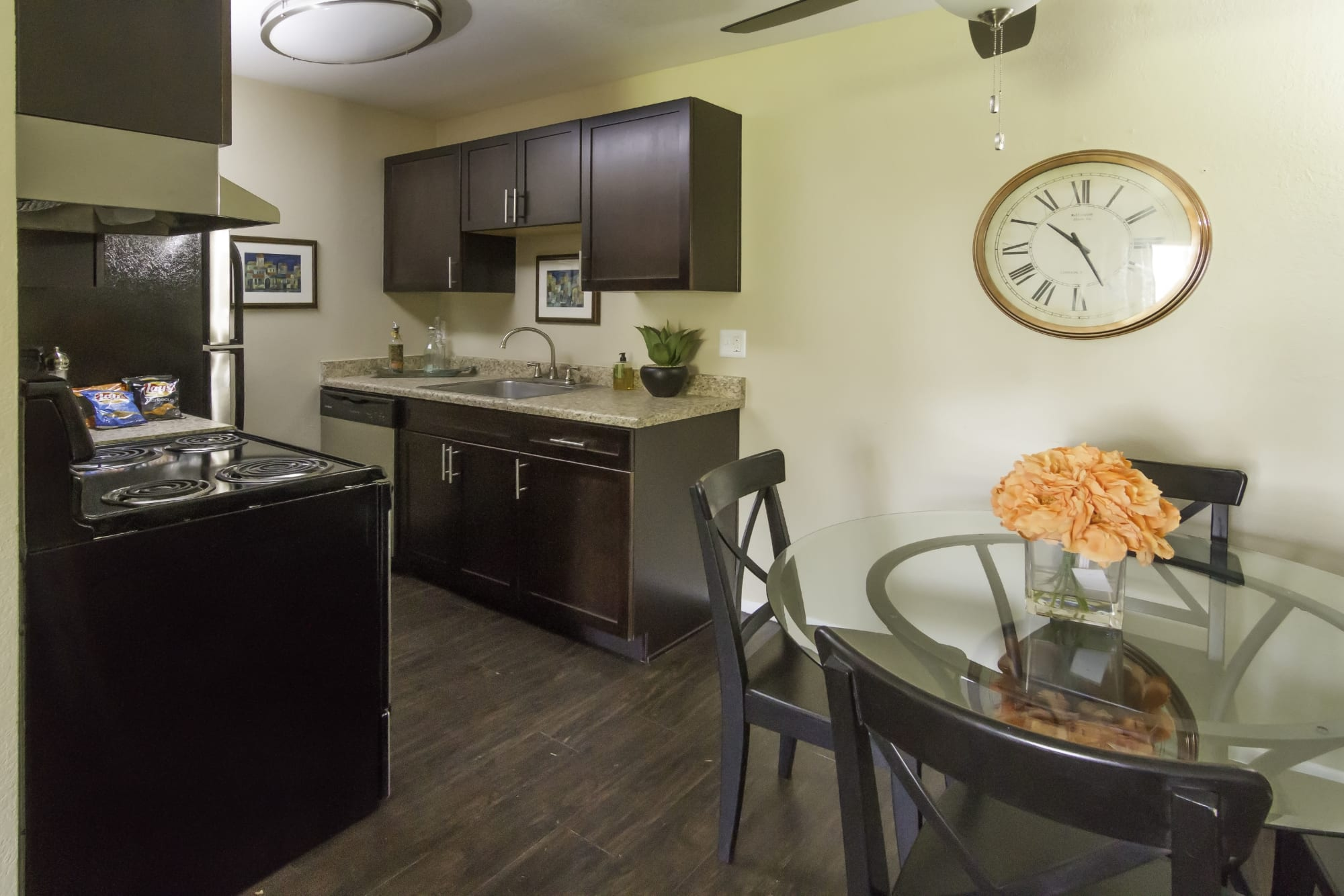 Stainless steel appliances in our renovated brown kitchens at Callaway Apartments in Taylorsville, UT