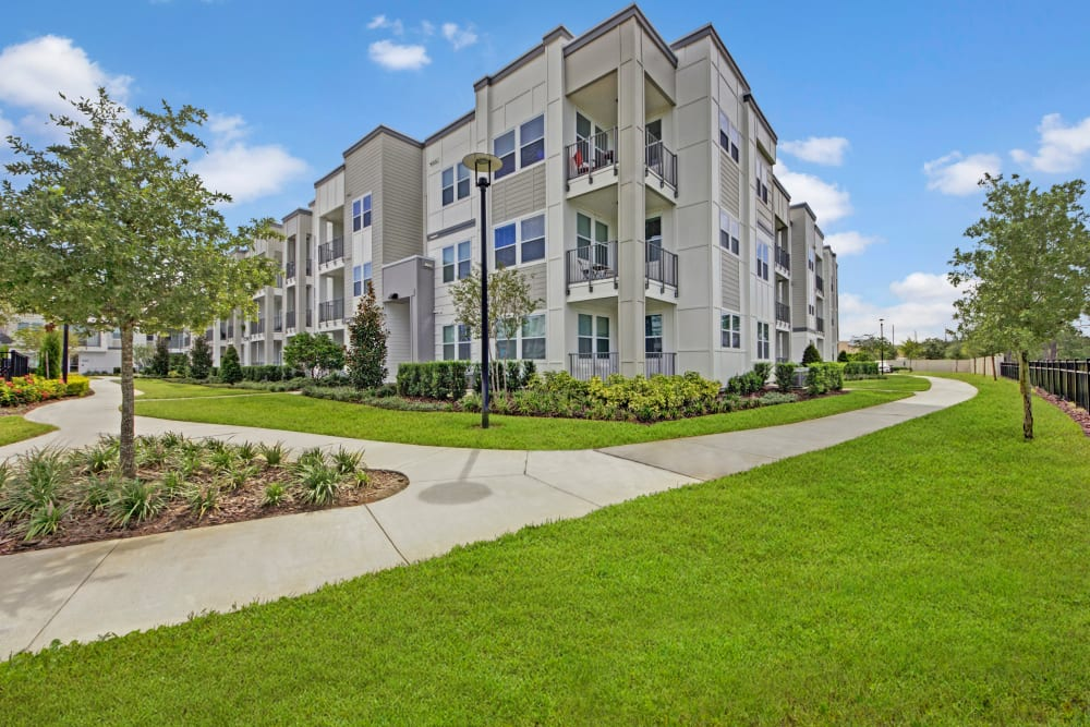 A walkway between apartment buildings at Linden on the GreeneWay in Orlando, Florida