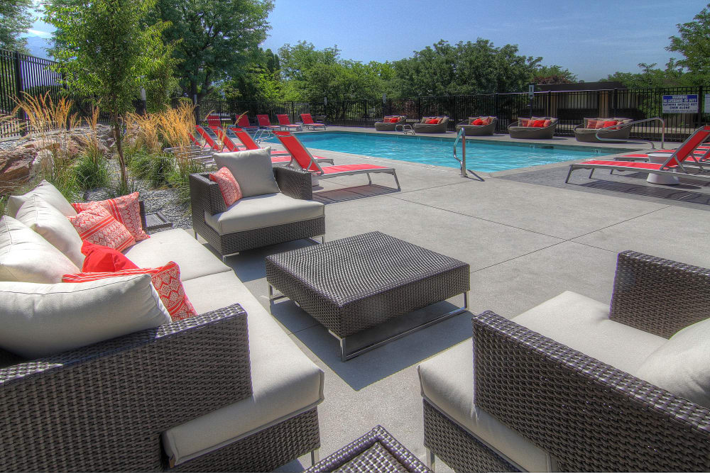 Lounge area near swimming pool at Sandpiper Apartments in Holladay, Utah