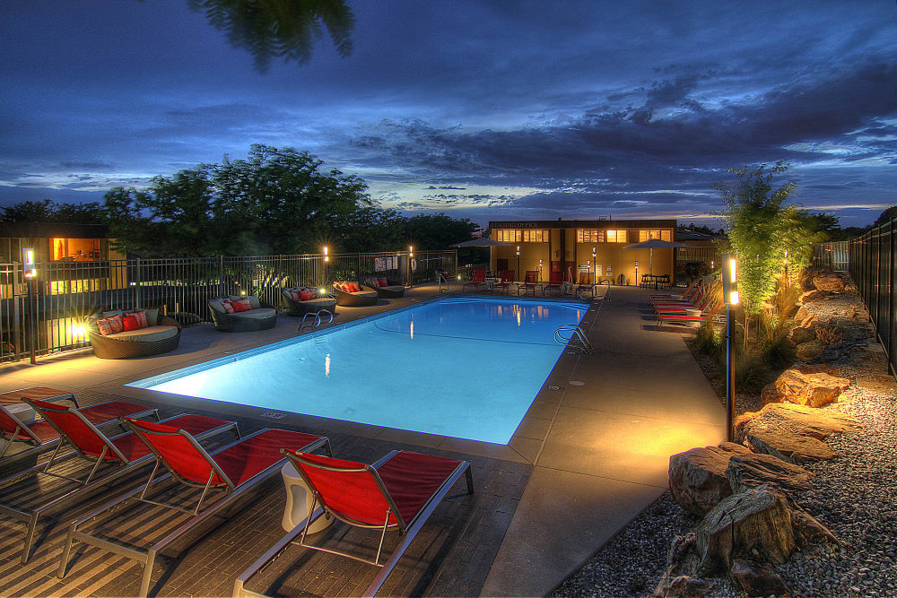 Night view of swimming pool at Sandpiper Apartments in Holladay, Utah