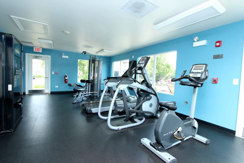 Fitness center with plenty of individual workout stations at West Line Apartments in Hanover Park, Illinois