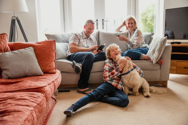 Happy family in their living room at Avilla Centerra Crossings in Goodyear, Arizona