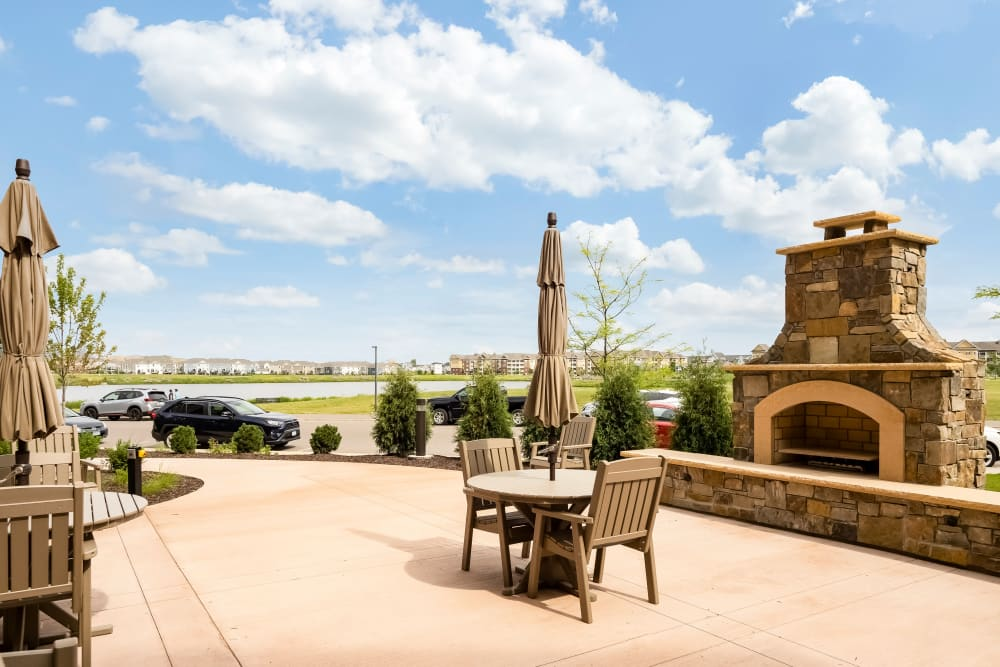 Outdoor Patio with Fireplace at Applewood Pointe Maple Grove at Arbor Lakes in Maple Grove, Minnesota