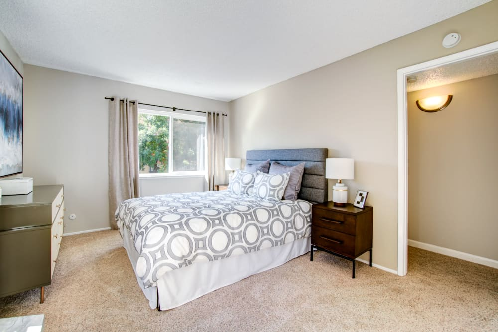 Enjoy apartments with a cozy bedroom at Waterstone Fremont