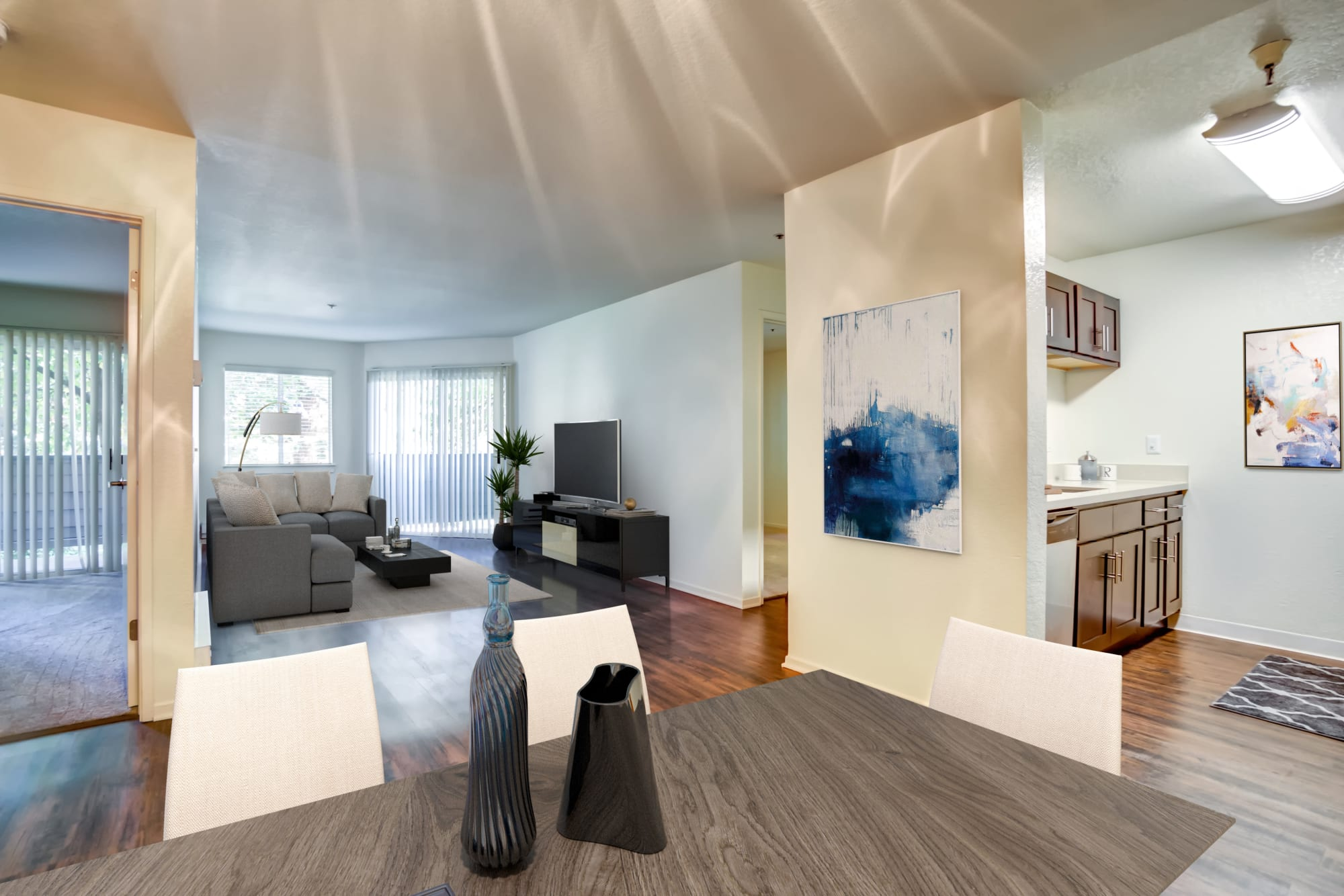 Hardwood-style floors in a living room at Serramonte Ridge Apartment Homes in Daly City, California