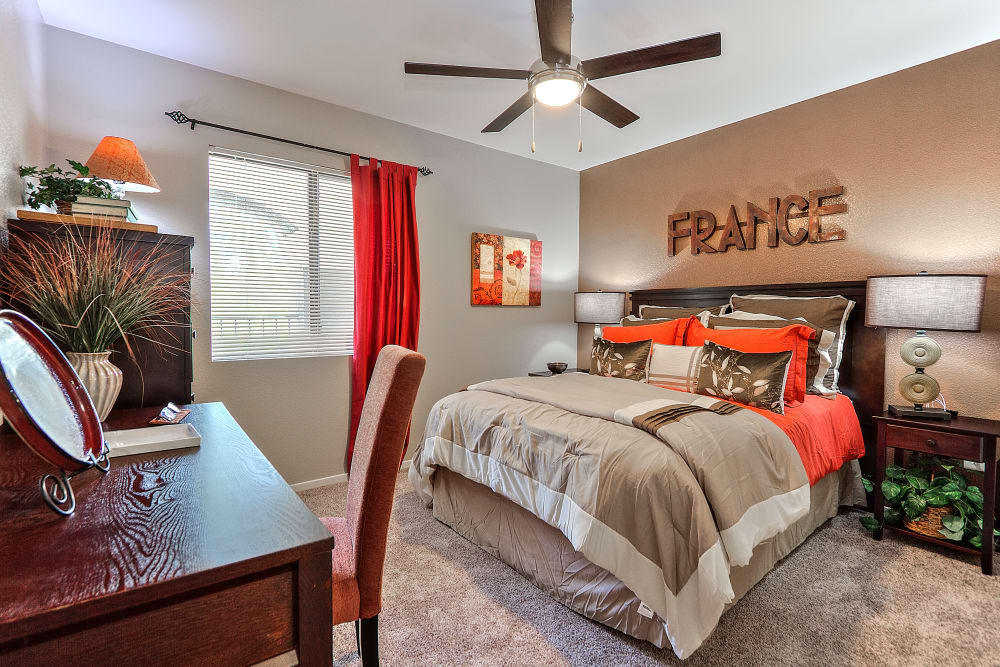 Bedroom with a ceiling fan at Cielo Apartment Homes in Henderson, Nevada