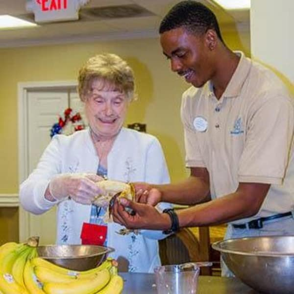 Resident cooking with care taker at The Retreat at Berryville in Berryville, Virginia