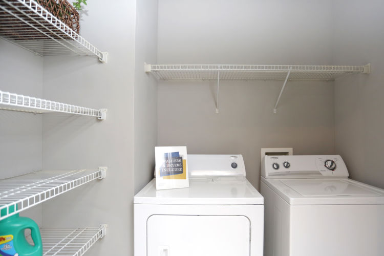 In-unit washer and dryer in a model home at Landing Square in Atlanta, Georgia