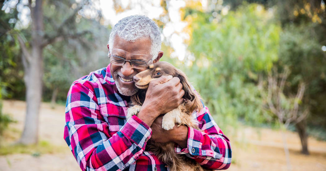 Resident and his dog loving their new neighborhood at Trails at Buda Ranch in Buda, Texas