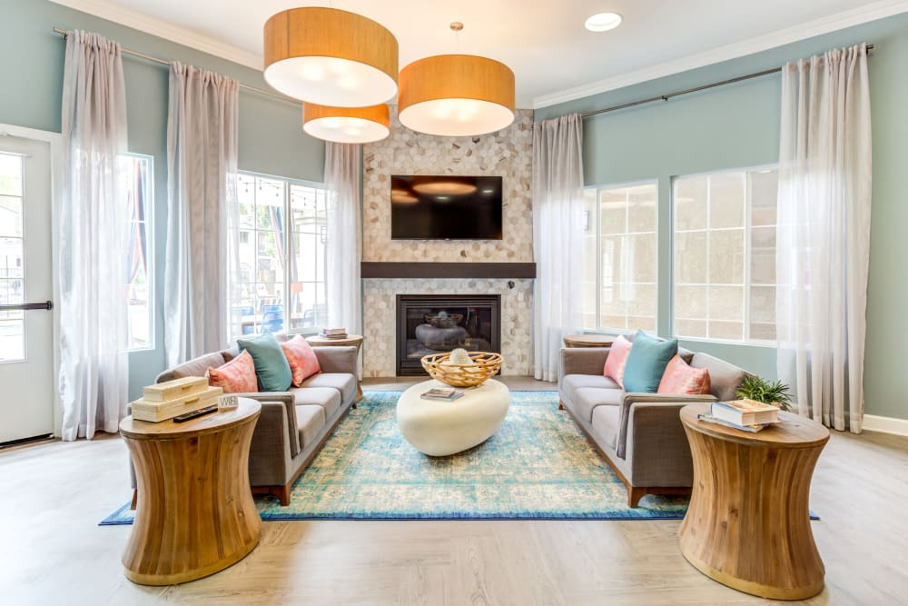 Luxurious lobby lounge area in front of the fireplace at Sofi Westview in San Diego, California