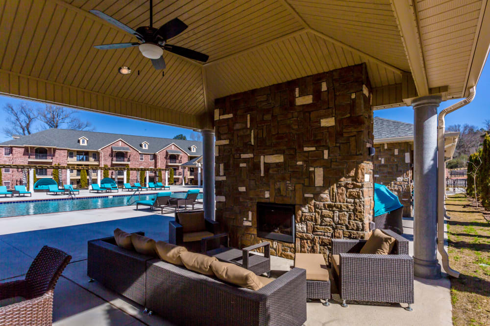 Outdoor seating and fireplace near pool at Arlo Luxury Apartment Homes in Little Rock, Arkansas