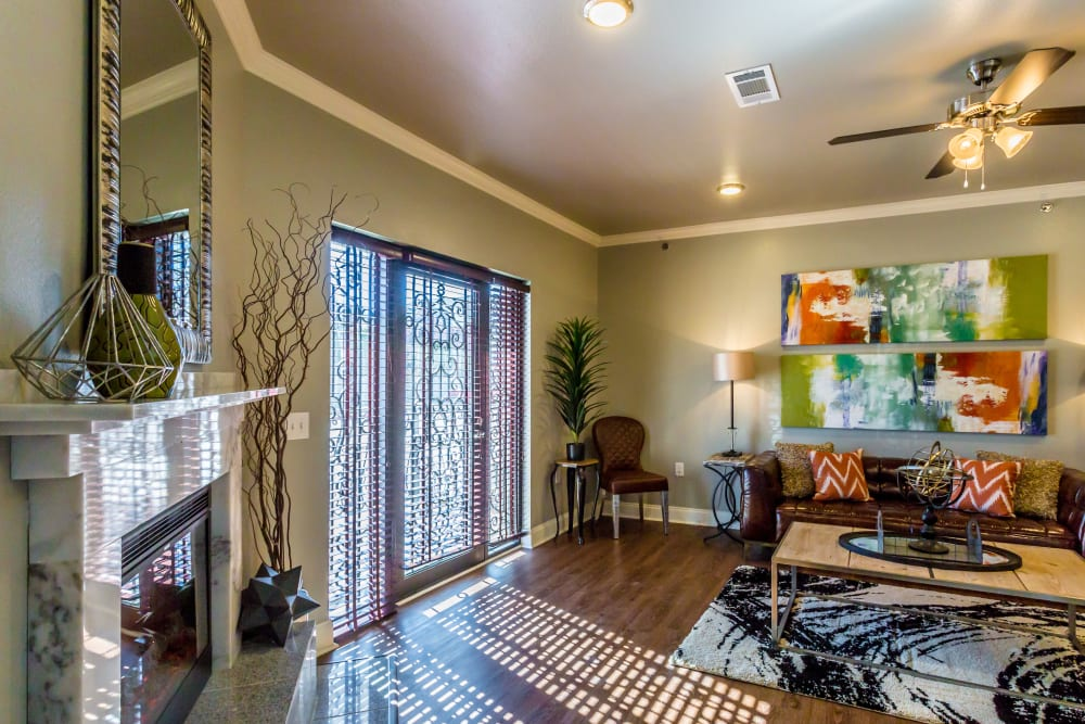 Model living room with sliding glass doors at Arlo Luxury Apartment Homes in Little Rock, Arkansas