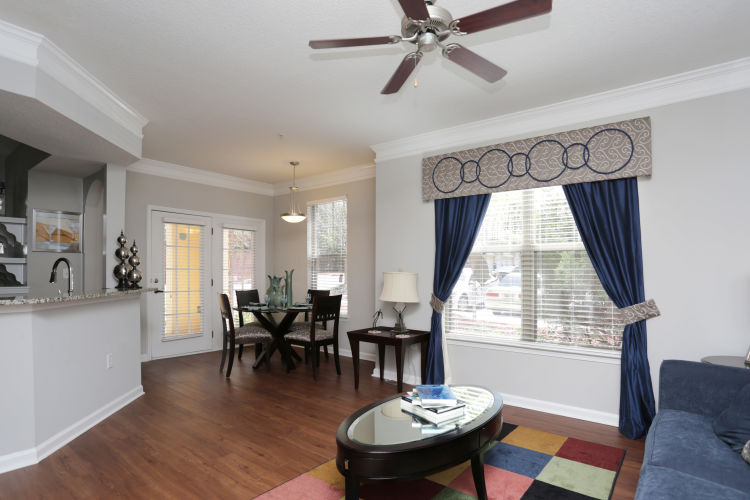 Ceiling fan and hardwood floors in a model home's living area at Landing Square in Atlanta, Georgia