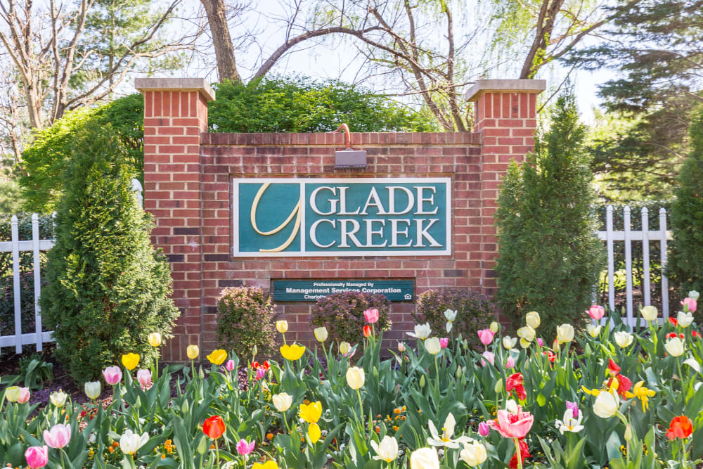 Entry way signage and garden of Glade Creek Apartments in Roanoke, Virginia