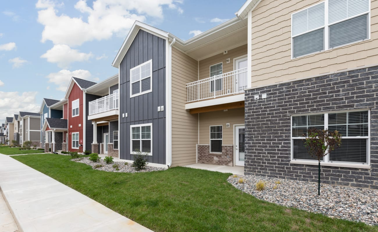 Exterior view of resident buildings and landscaping at Bonterra Apartments in Fort Wayne, Indiana