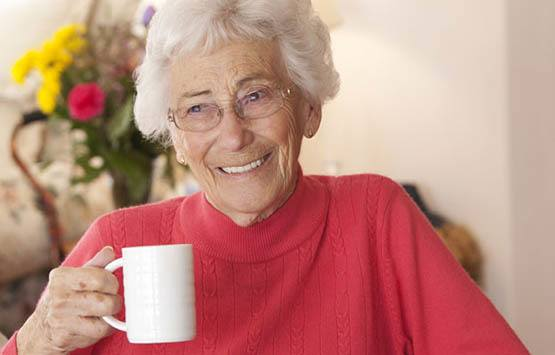 Resident enjoying a cup of tea at Randall Residence of Centerville in Centerville, Ohio