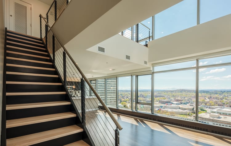 Staircase within the penthouse at Tower280 in Rochester, NY