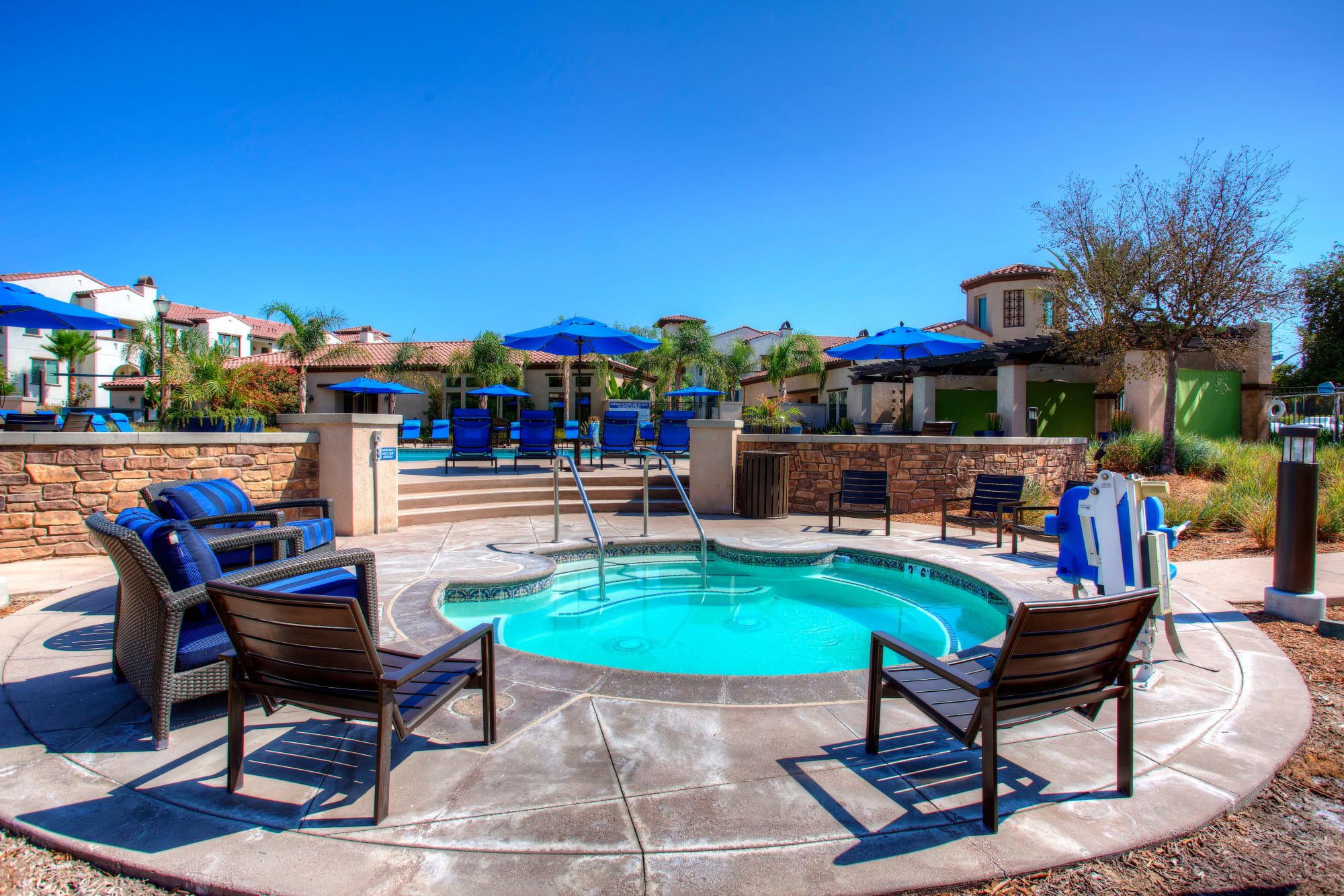 Deck chairs around the hot tub at Palisades Sierra Del Oro in Corona, California