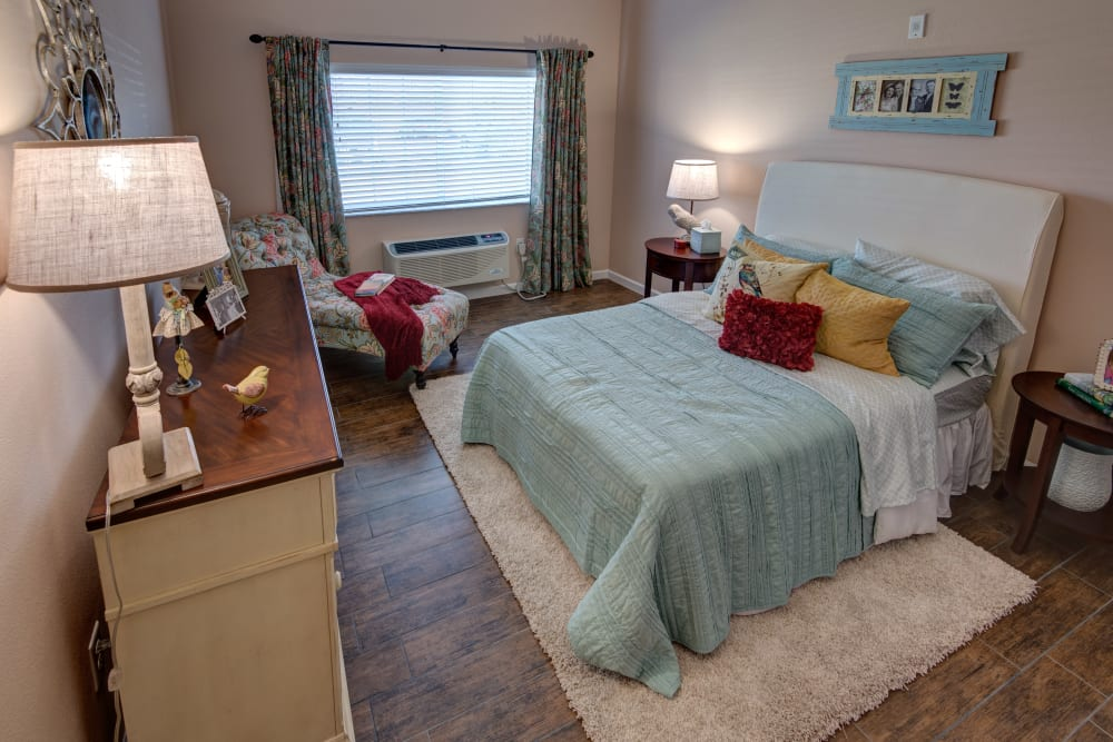 Spacious resident bedroom at Inspired Living at Hidden Lakes in Bradenton, Florida