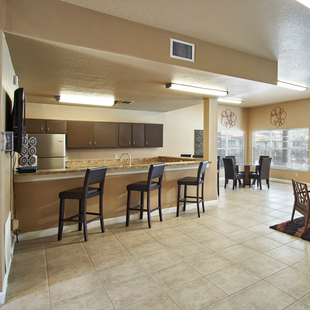 A community kitchen with a bar at Calais Park Apartments in St Petersburg, Florida