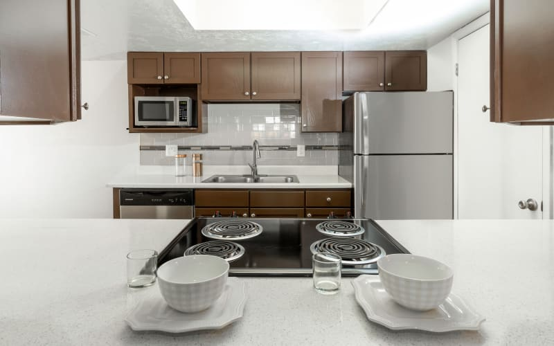 Espresso cabinets in a kitchen at Windgate Apartments in Bountiful, Utah