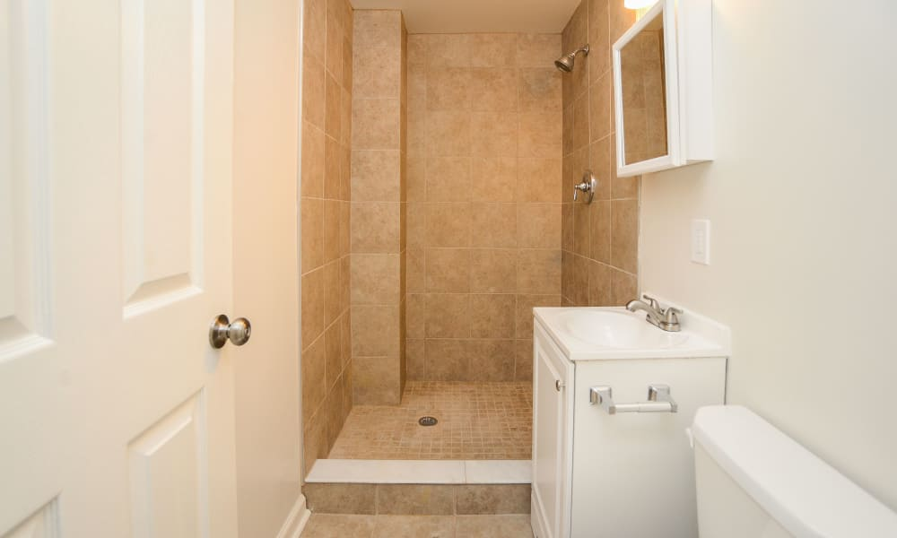 Nice tile shower at Westminster Towers Apartment Homes