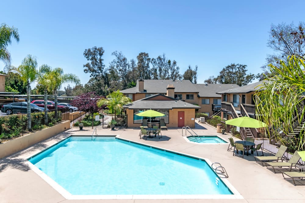 Hot tub and swimming pool at Hillside Terrace Apartments in Lemon Grove, California