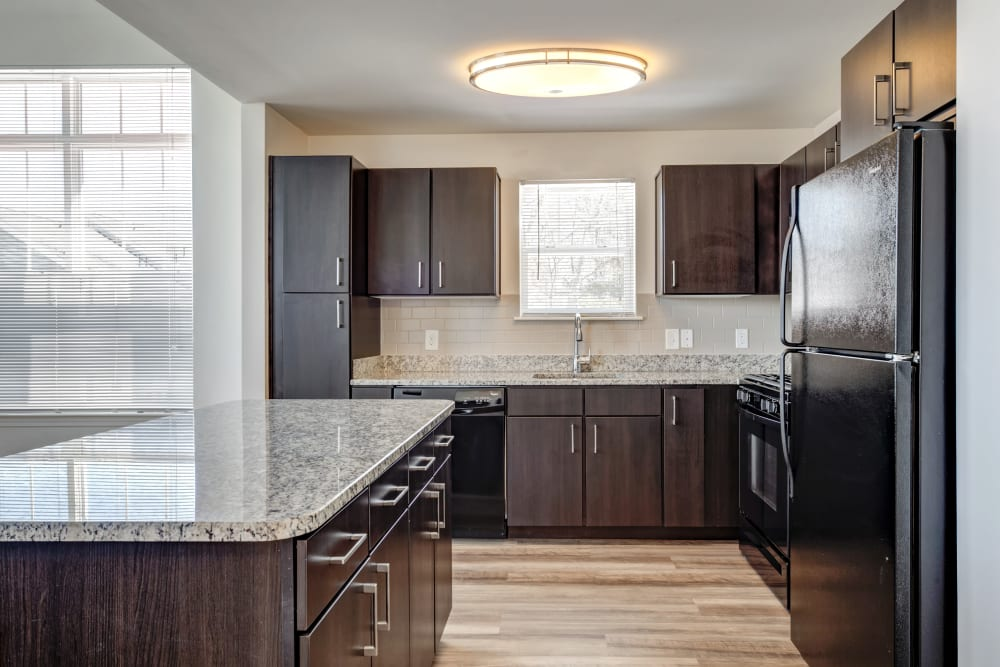 Beautiful brown kitchen at Prynne Hills in Canton, Massachusetts