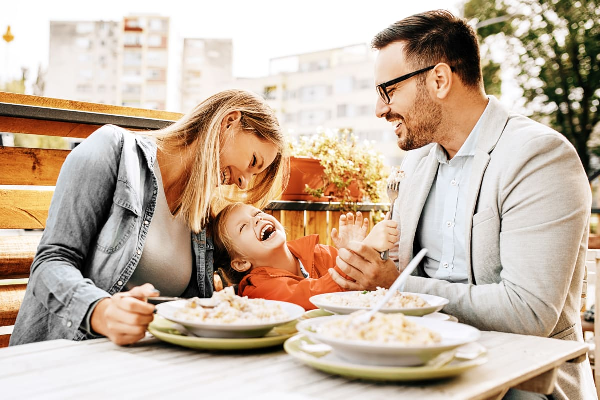 Couple having dinner with child outdoors in Fort Worth, Texas from Marquis at Stonegate