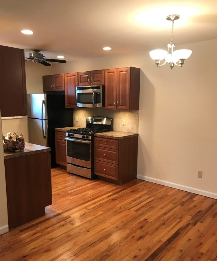 Living model with hardwood flooring at apartments in Spring Lake, New Jersey