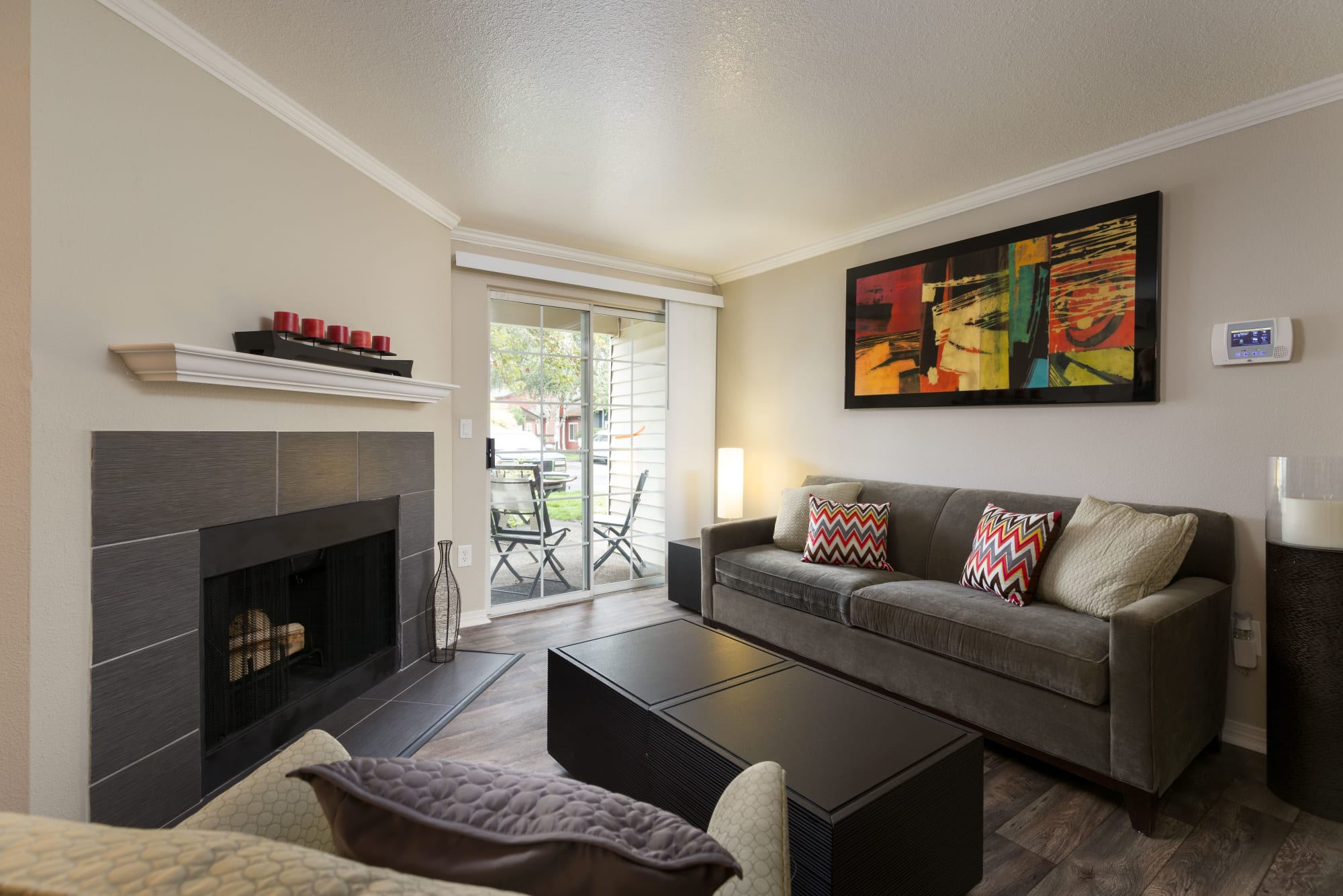 Living Room With Chimney at Walnut Grove Landing Apartments in Vancouver, WA