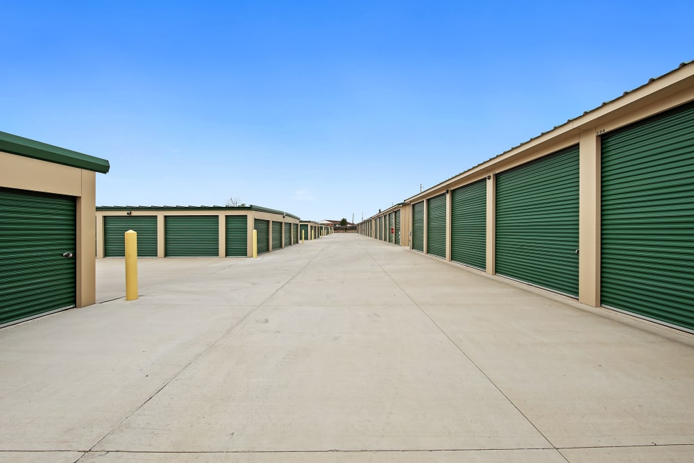 Exterior units with green doors at Storage Star Cheyenne in Cheyenne, Wyoming