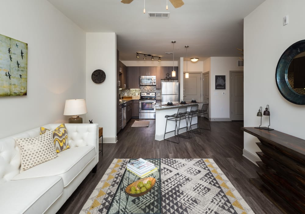 Enjoy a luxury living room and a modern kitchen at One Metrocenter in Nashville, Tennessee