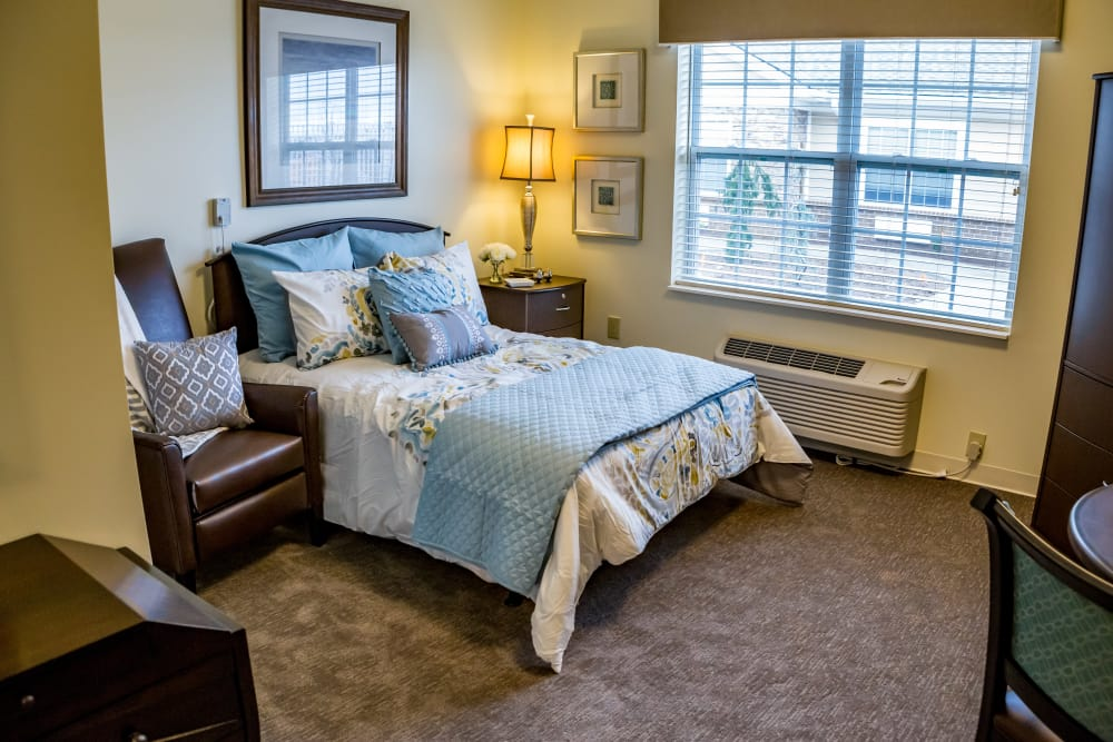 Bedroom with big window at Senior Living Facility in Lexington, Kentucky