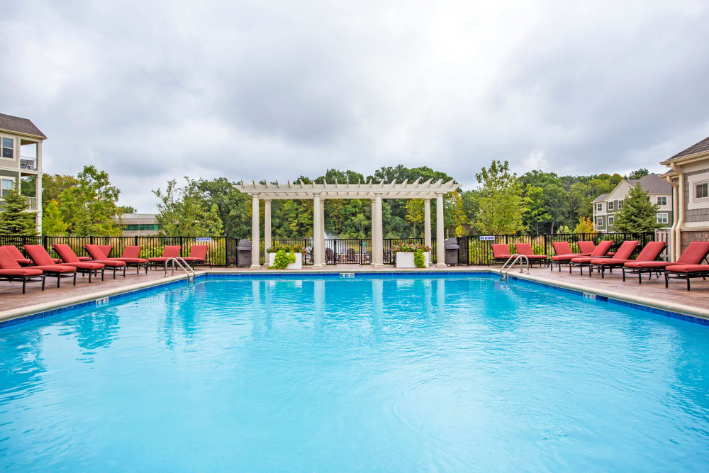 Large resort-style swimming pool with plenty of lounge chairs at The Oaks Of Vernon Hills in Vernon Hills, Illinois