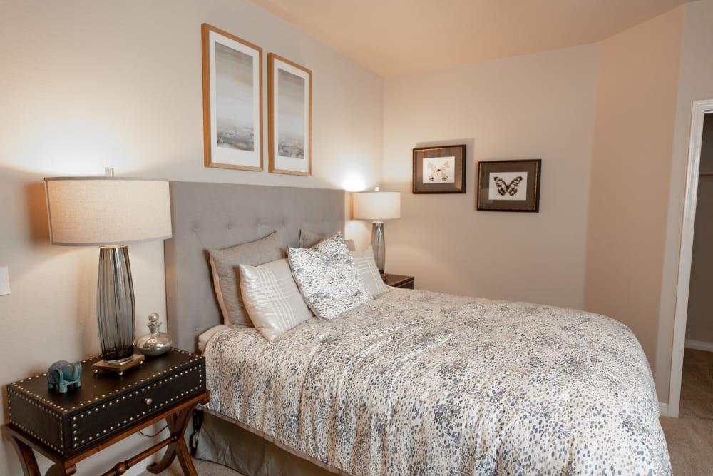 Model bedroom with natural lighting at Wolf Ranch Condominium Rentals in Sacramento, California
