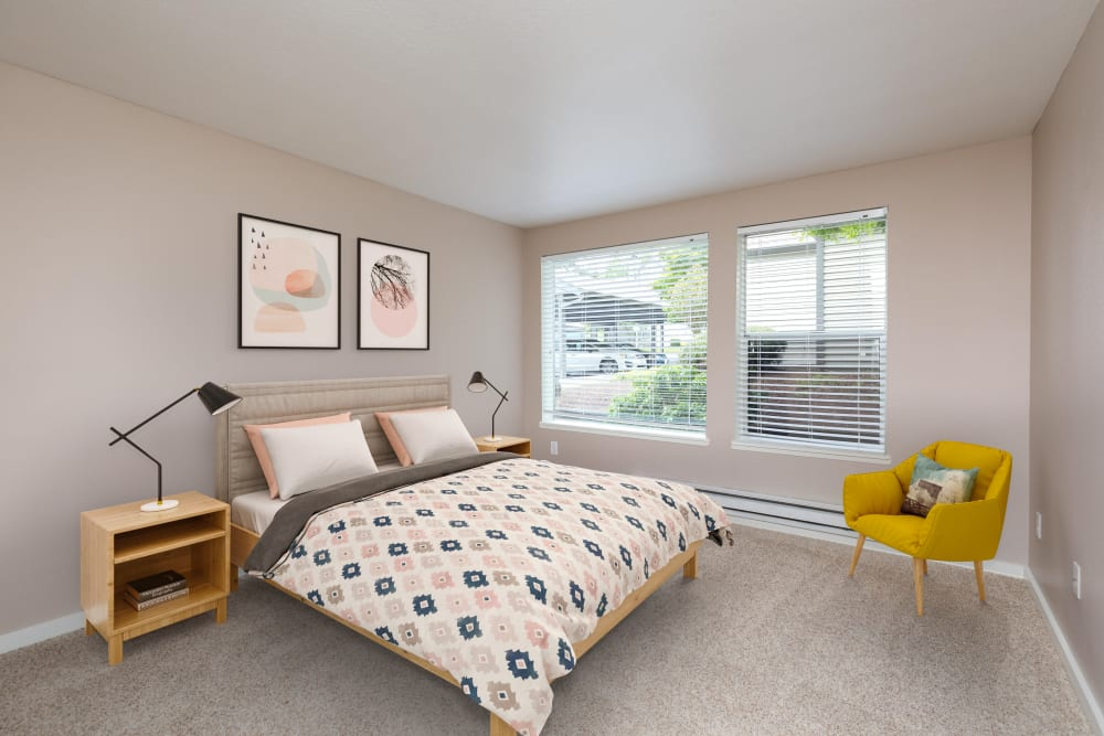 Master bedroom with a large window for natural lighting at Meadows at Cascade Park Apartments in Vancouver, Washington