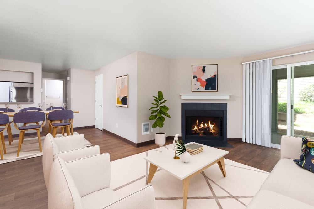 A living room complete with a fireplace at Meadows at Cascade Park Apartments in Vancouver, Washington