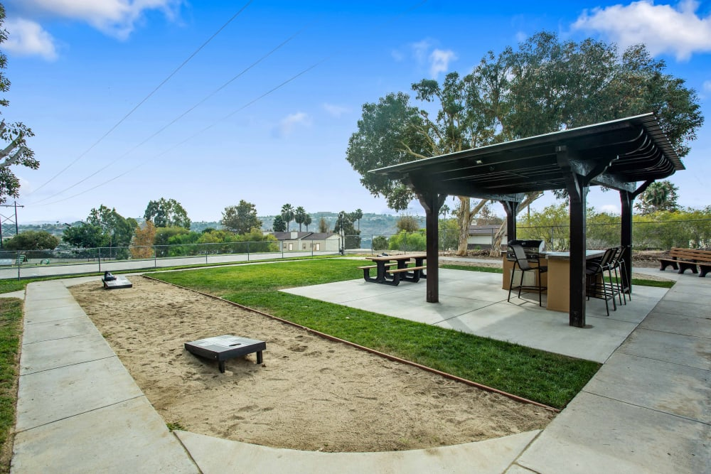 Corn hole and covered grills at Shadow Ridge Apartments in Oceanside, California