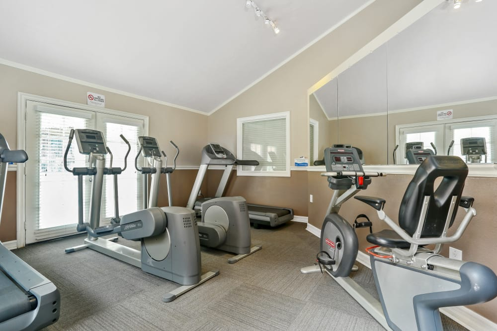 Fitness center with plenty of individual workout stations at Shadow Ridge Apartments in Oceanside, California