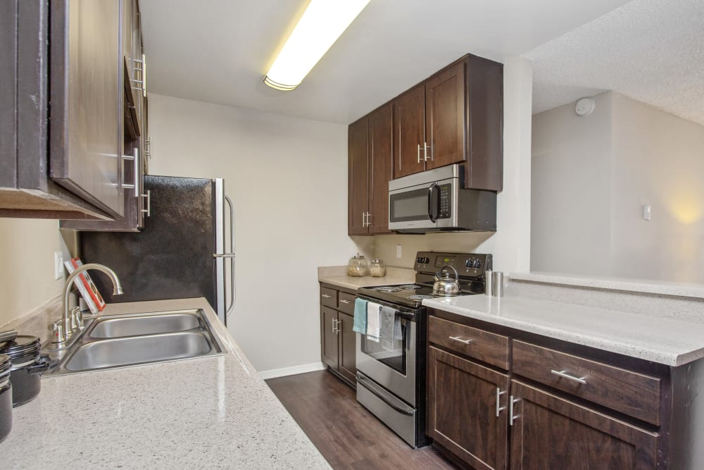 A kitchen with granite-style counter tops at Shadow Ridge Apartments in Oceanside, California