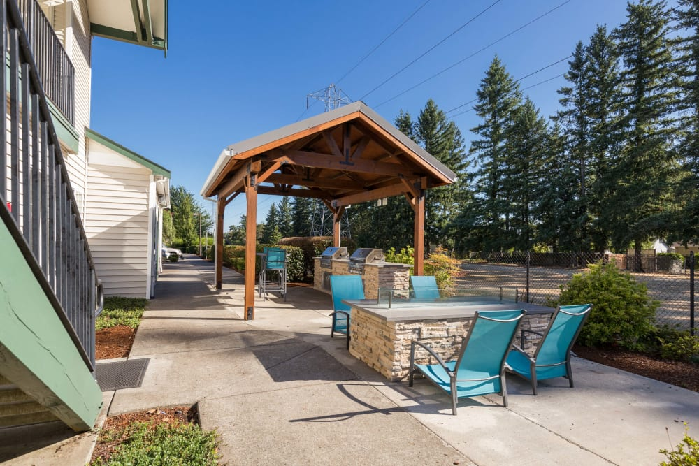 Lounge area with a fire pit at The Landings at Morrison Apartments in Gresham, Oregon