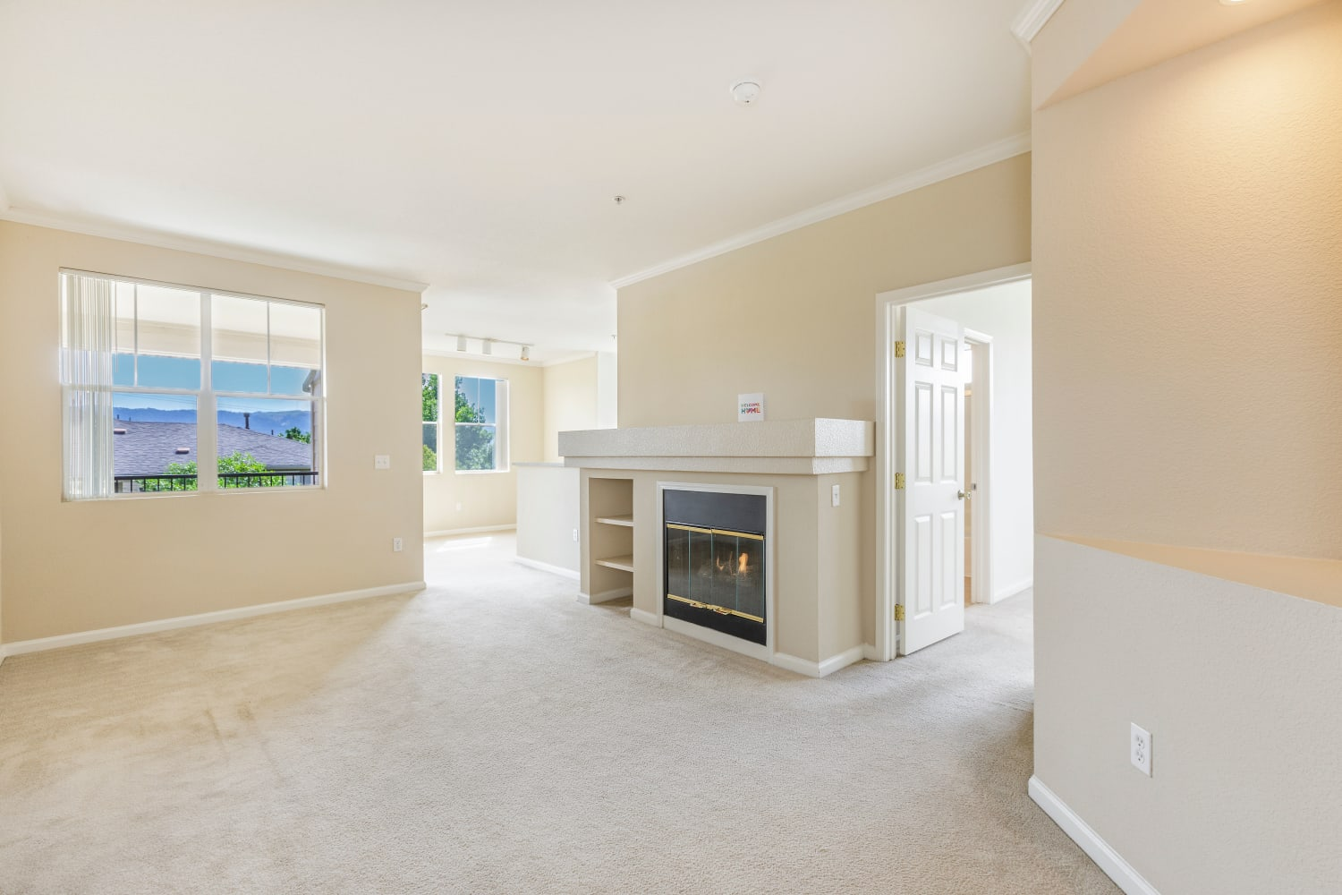 A fireplace in a beautiful open living room floor plan at Park Hacienda Apartments in Pleasanton, California