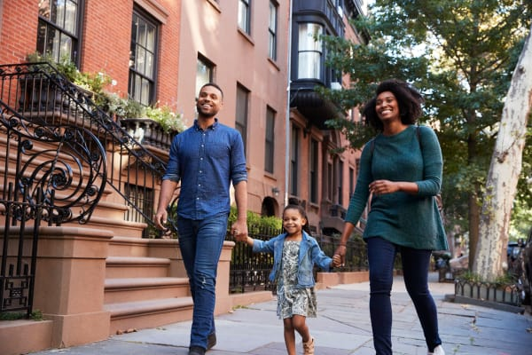 Family enjoying a walk near Winston Apartments in Baltimore, Maryland