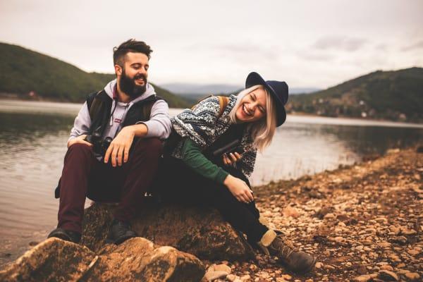 Smiling couple enjoying nature in Salem, Oregon near South Block Apartments