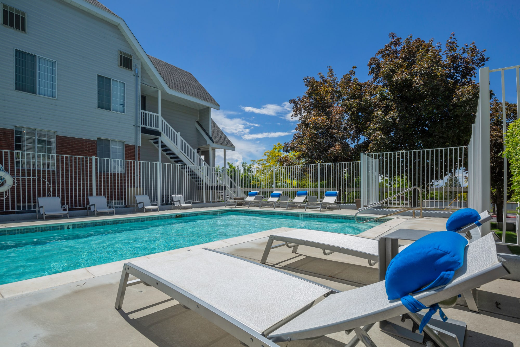 Poolside lounge chairs at Windgate Apartments in Bountiful, Utah