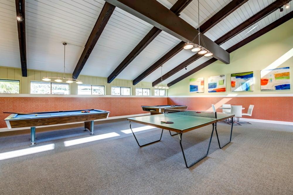 Ping pong table and shuffleboard in the game room at Sofi Ventura in Ventura, California