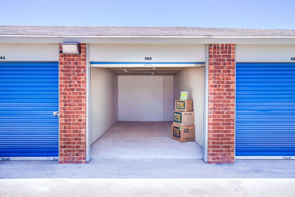 Open outdoor unit with packages at Metro Self Storage in Topeka, Kansas