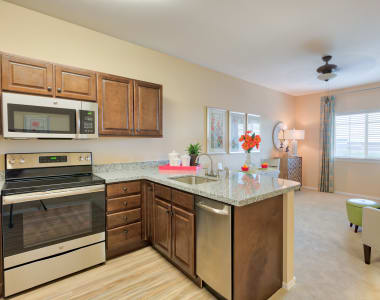 Kitchen and living area in model senior private cottage at Burr Ridge Senior Living