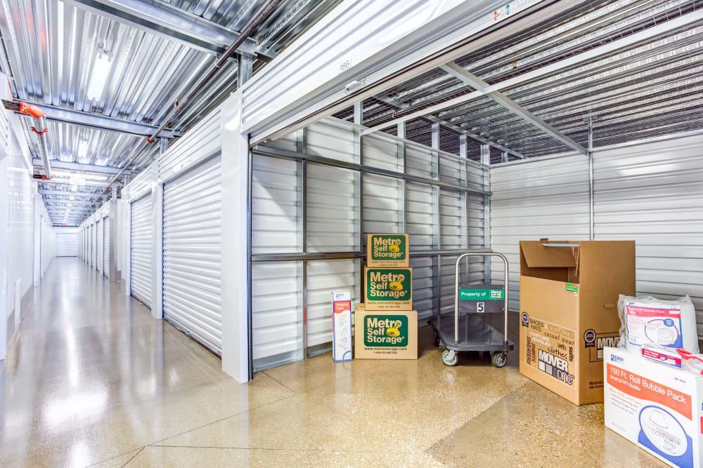 Open indoor unit with packages at Metro Self Storage in Northbrook, Illinois